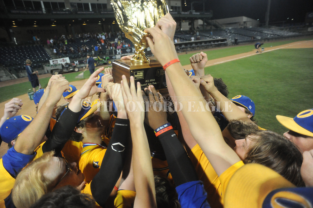 Oxford High players accept the trophy following the win vs. George County in the MHSAA Class 5A state championship at Trustmark Park in Pearl, Miss. on Thursday, May 21, 2015. Oxford won 9-0 to win its second state title in baseball and its first since 2005.