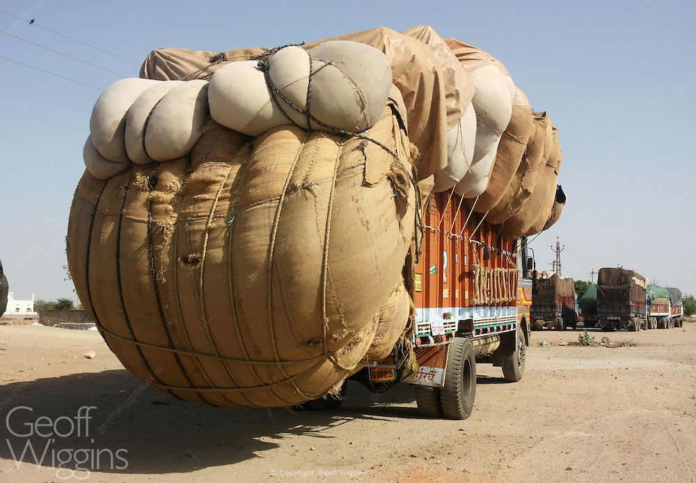 Overloaded Indian freight truck carrying cotton, Rajasthan, India,