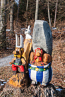 Carved, painted wooden Asterix and Obelix in the woods near Jonen, Switzerland.