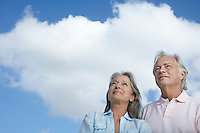 Portrait of senior couple against sky looking up