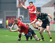 Scarlets' John Barclay offloads in the tackle<br /> <br /> Photographer Simon King/Replay Images<br /> <br /> Guinness PRO14 Round 19 - Scarlets v Glasgow Warriors - Saturday 7th April 2018 - Parc Y Scarlets - Llanelli<br /> <br /> World Copyright &copy; Replay Images . All rights reserved. info@replayimages.co.uk - http://replayimages.co.uk