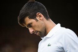 July 3, 2018 - London, U.S. - LONDON, ENGLAND - JULY 03: Novak Djokovic (SRB) in action during his first round match of Wimbledon on July 3, 2018, at All England Lawn Tennis and Croquet Club in London, England. (Photo by Cynthia Lum/Icon Sportswire) (Credit Image: © Cynthia Lum/Icon SMI via ZUMA Press)