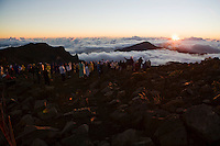 A large group of people watching the sun rise atop Haleakala Volcano on Maui, Hawaii September, 2008
