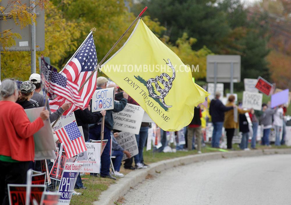 Town of Wallkill, New York - People with flags and signs stand on the side of Route 211 during a rally organized by the Orange/Sullivan County 912 Tea Party on Oct. 23, 2010.