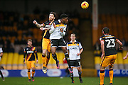 Bradford City midfielder Romain Vincelot (6)  challenges Port Vale forward JJ Hooper  (10) in the air during the EFL Sky Bet League 1 match between Port Vale and Bradford City at Vale Park, Burslem, England on 25 February 2017. Photo by Simon Davies.
