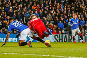 Alfredo Morelos leaves a little on Lewis Ferguson of Aberdeen FC during the William Hill Scottish Cup quarter final replay match between Rangers and Aberdeen at Ibrox, Glasgow, Scotland on 12 March 2019.