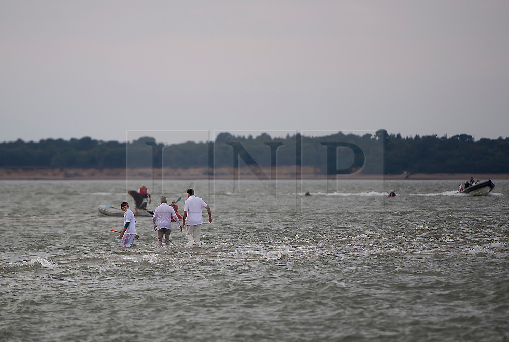 © Licensed to London News Pictures. 18/09/2016. Portsmouth, UK. The teams arrive. Teams take part in the  Bramble Bank Cricket Match in the middle of The Solent strait on September 18, 2016. The annual cricket match between the Royal Southern Yacht Club and The Island Sailing Club, takes place on a sandbank which appears for 30 minutes at lowest tide. The game lasts until the tide returns. Photo credit: Ben Cawthra/LNP