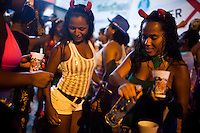 Young women dance samba and drink vodka during Carnaval, in Rocinha,  the biggest favela in Brazil, with over 100,000 residents, in Rio de Janeiro, Br., on Thursday, Jan. 24, 2013. In early November 2011 about 3,000 police officers and soldiers moved into one of the largest slums in Latin America in an effort by the Brazilian government to assert control over lawless areas of the city ahead of the 2014 World Cup and 2016 Summer Olympics.