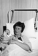 Beatrice Behan and her newborn daughter, at the Rotunda Hospital, Dublin..29.11.1963