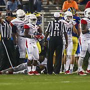 Delaware State Quarterback KOBIE LAIN (2), CENTER, holds his eye after being tackled during a week one game between the Delaware Blue Hens and the Delaware State Hornets, Thursday, Sept. 01, 2016 at Tubby Raymond Field at Delaware Stadium in Newark, DE.
