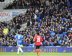 Cardiff City fans leave the ground in a large cue after they see their side concede a fourth goal - Photo mandatory by-line: Joe Meredith/JMP - Tel: Mobile: 07966 386802 22/02/2014 - SPORT - FOOTBALL - Cardiff - Cardiff City Stadium - Cardiff City v Hull City - Barclays Premier League