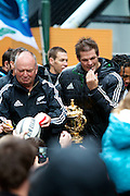 Graham Henry and Richie McCaw of the New Zealand All Blacks, 2011 Rugby World Cup champions, parade through the streets of Wellington. Rain and strong wind wasn't enough to deter Wellington locals from welcoming their heroes.