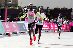 Mo Farah on his way to crossing the finish line to win the men's race during the Vitality Big Half in London.