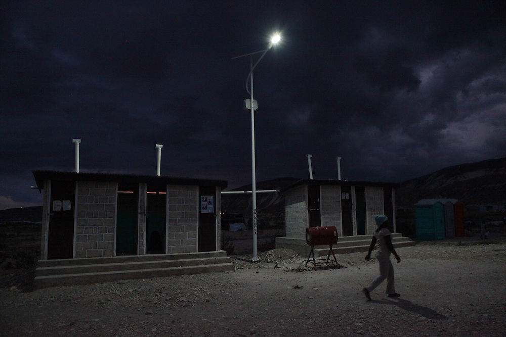 Newly installed solar lights provide security for the residents of Camp Coreil, a displaced persons camp outside Port au Prince, Haiti, Tuesday, April 12, 2011. More than 650,000 Haitians remain displaced since the January 12, 2010 earthquake. (AP Photo/Stuart Ramson for United Nations Foundation)