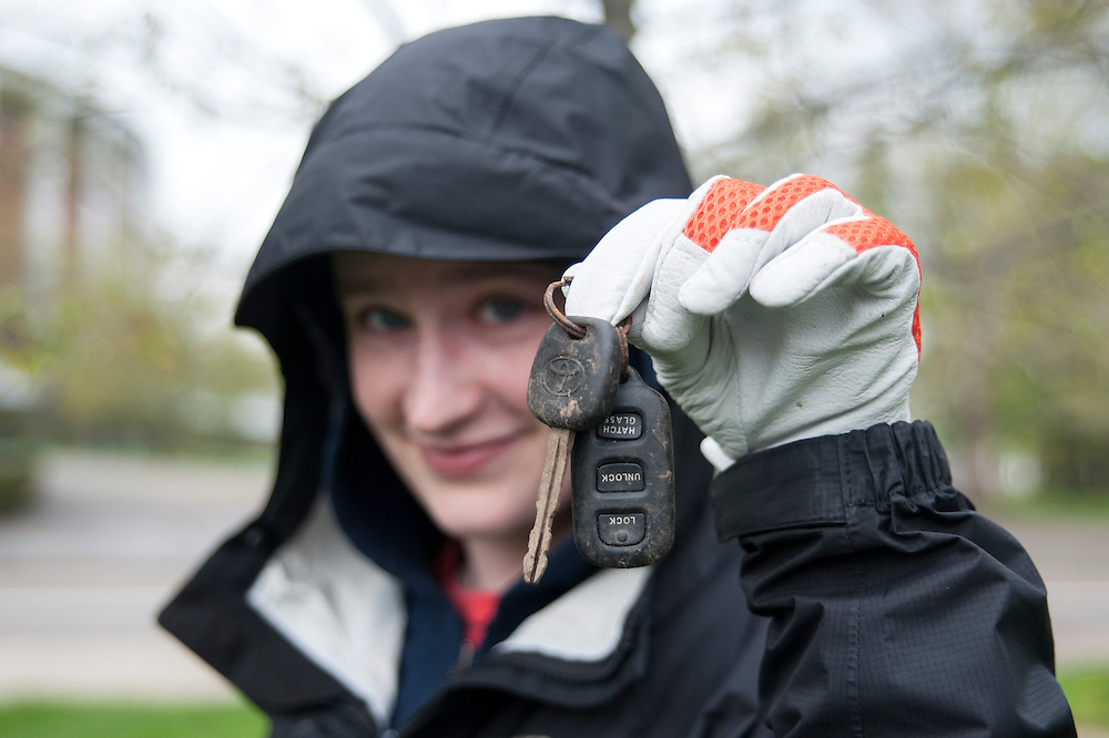Kate Hiller holds up one of the items found along Richland Avenue on Sunday, April 19.