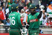 Liton Das of Bangladesh and Shakib Al Hasan (vc) of Bangladesh touch gloves during the ICC Cricket World Cup 2019 match between Bangladesh and India at Edgbaston, Birmingham, United Kingdom on 2 July 2019.