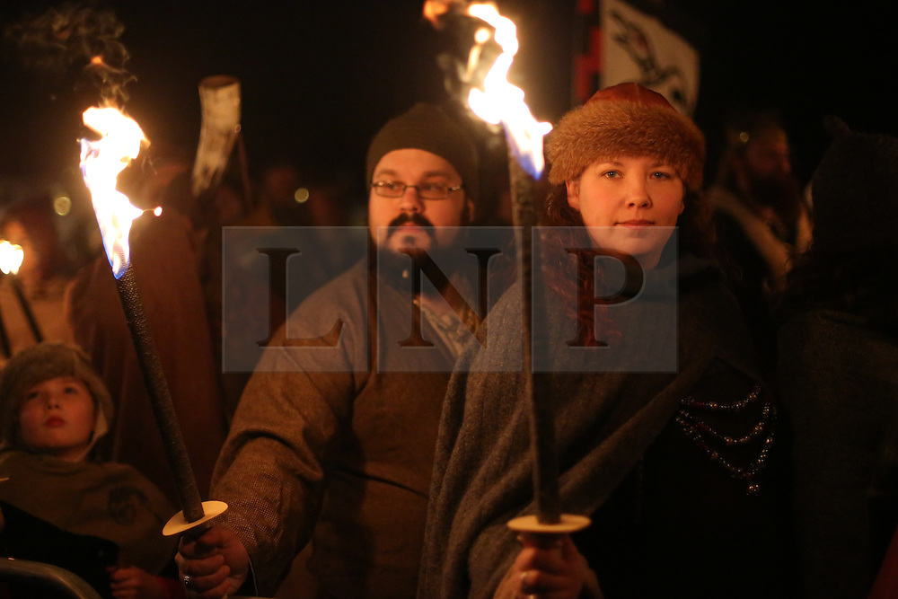 © Licensed to London News Pictures. 20/02/2016. York, UK. Vikings carry burning torches during the finale of the annual Jorvik Viking Festival in York, North Yorkshire. The historic city was transformed into a fiery battleground as this year's end to the week long festival told the story of the infamous Battle of Assundun. The festival, which is run by the Jorvik Viking Centre, takes place every February in tradition of an ancient Viking festival known as Jolablot.  Photo credit : Ian Hinchliffe/LNP