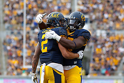 BERKELEY, CA - SEPTEMBER 12:  Running back Daniel Lasco #2 of the California Golden Bears is congratulated by running back Vic Enwere #23 after scoring a touchdown against the San Diego State Aztecs during the third quarter at California Memorial Stadium on September 12, 2015 in Berkeley, California. The California Golden Bears defeated the San Diego State Aztecs 35-7. (Photo by Jason O. Watson/Getty Images) *** Local Caption *** Daniel Lasco; Vic Enwere