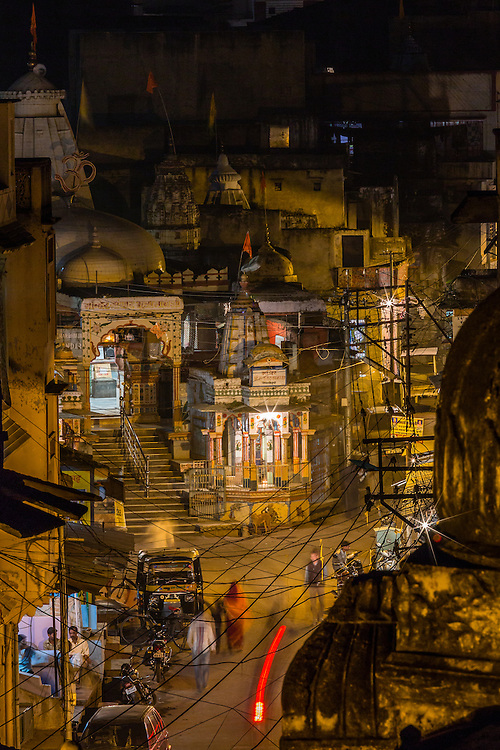 As the lighs go on during the evening, in Bundi, one of the many temples in one of the main streets of the old part of town is iluminated.