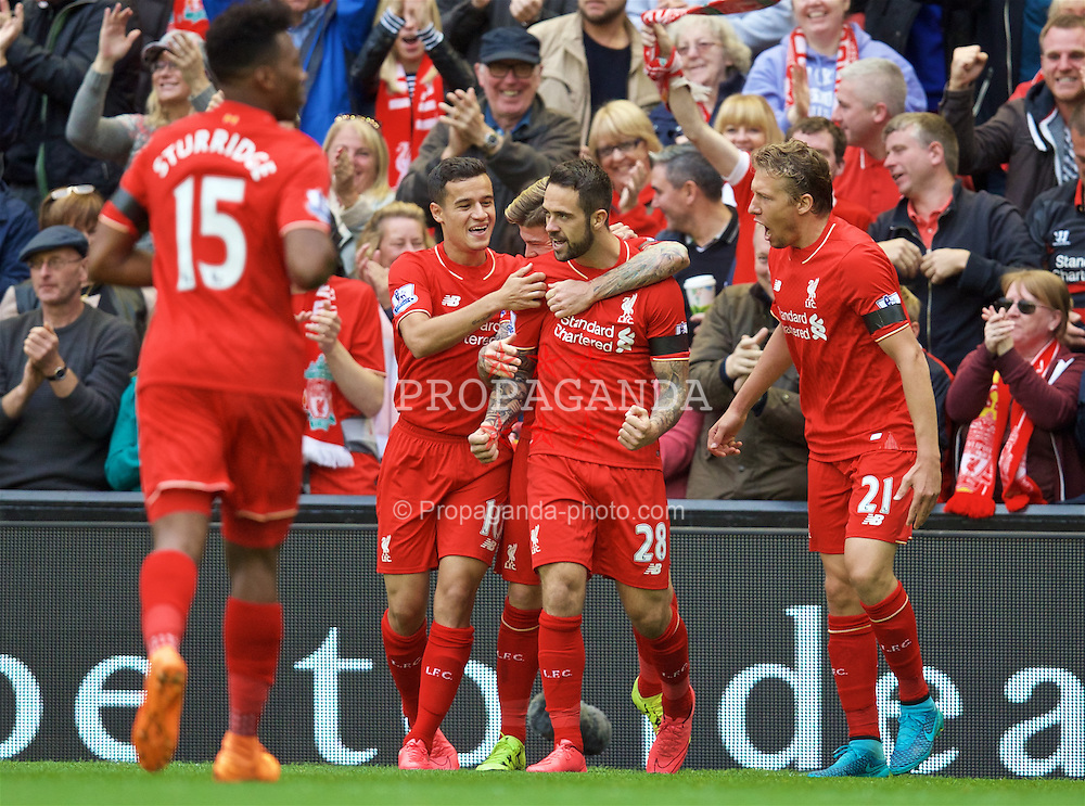 LIVERPOOL, ENGLAND - Sunday, September 20, 2015: Liverpool's Danny Ings celebrates scoring the first goal with team mates Philippe Coutinho Correia and Lucas Leiva during the Premier League match against Norwich City at Anfield. (Pic by David Rawcliffe/Propaganda)