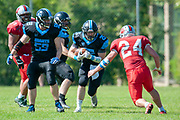 Giants Sam Broughton (#25) takes on Wolves Jason Gray (#24) during the BAFA Northern Division match between Edinburgh Wolves and Sheffield Giants at Meggetland Sports Complex, Edinburgh, Scotland on 1 July 2018. Picture by Malcolm Mackenzie.
