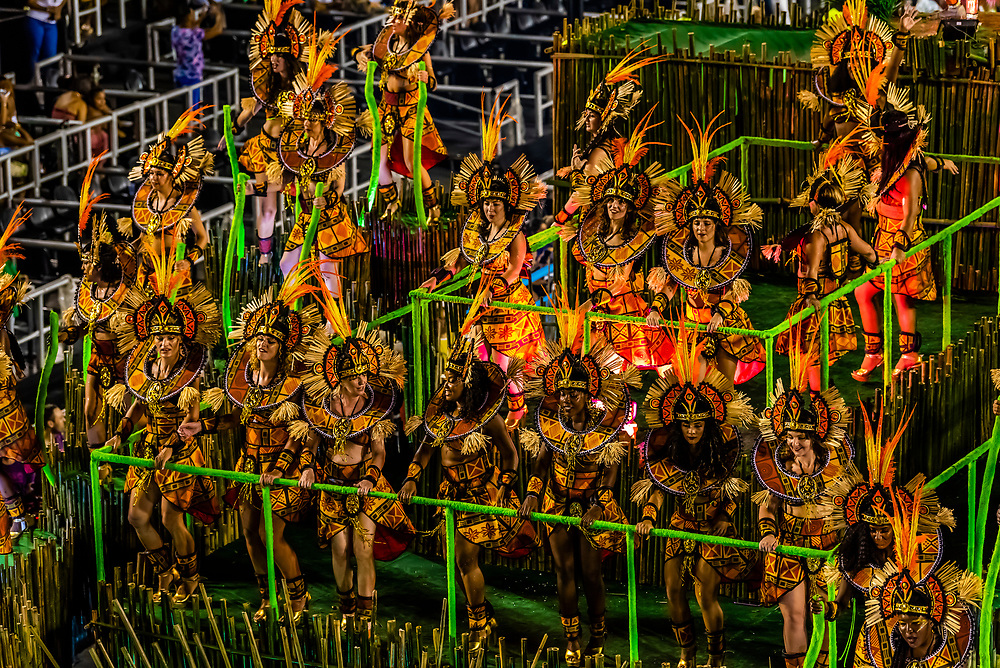 Performers on floats in the Carnaval parade of Academicos da Rocinha samba school in the Sambadrome, Rio de Janeiro, Brazil.