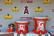 ANAHEIM, CA - JULY 21:  The team logo and corporate logos adorn the dugout wall as drink cups and coolers await the team on a hot day prior to the Los Angeles Angels of Anaheim game against the Texas Rangers on July 21, 2011 at Angel Stadium in Anaheim, California. The Angels won the game in a 1-0 shutout. (Photo by Paul Spinelli/MLB Photos via Getty Images)