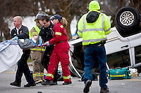 JEROME A. POLLOS/Press..Rescue workers carry accident victim Cody Sizemore, 13, to a waiting ambulance after he was extricated from an overturned vehicle.