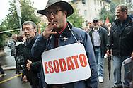 Contestazione al Jobs Act di Matteo Renzi. Manifestazione della Fiom. Esodato. Milano, 8 ottobre 2014.