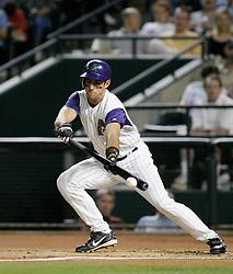 Phoenix, AZ-05-07-04 Arizona Diamondbacks 2nd baseman Matt Kata lays down a bunt in the first inning against the Philadelphia Phillies.The Phillies won 4-1. Ross Mason photo