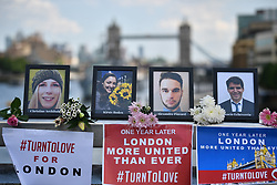 © Licensed to London News Pictures. 03/06/2018. London, UK.  Pictures of the eight victims are placed on the bridge by Campaigners ahead of a minutes silence for the victims of the 2017 London Bridge terror attack at London Bridge. Eight people were killed and 48 were injured when a van was deliberately driven into pedestrians on London Bridge. Three occupants then ran to the nearby Borough Market area carrying knives and fake explosives. Photo credit: Ben Cawthra/LNP