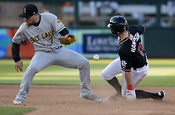 May 22, 2018 - U.S. - ASEC -- The Isotopes' Garrett Hampson steals 2nd base as Salt Lake short stop Nolan Fontana misses the throw in the third inning of the game in Isotopes Park on Tuesday, May 22, 2018. (Credit Image: © Greg Sorber/Albuquerque Journal via ZUMA Wire)