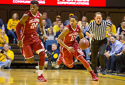 Feb 20, 2016; Morgantown, WV, USA; Oklahoma Sooners guard Isaiah Cousins (11) dribbles the ball during the first half against the West Virginia Mountaineers at the WVU Coliseum. Mandatory Credit: Ben Queen-USA TODAY Sports