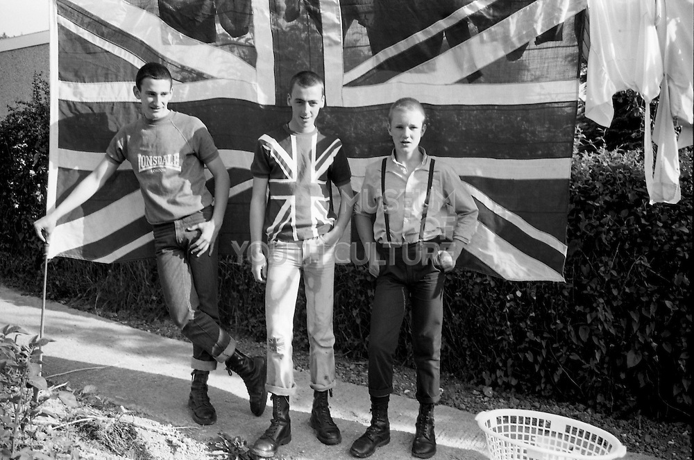 Gavin, Symond and Lee with a Union Jack, Hawthorne Road, High Wycombe, UK, 1980s.