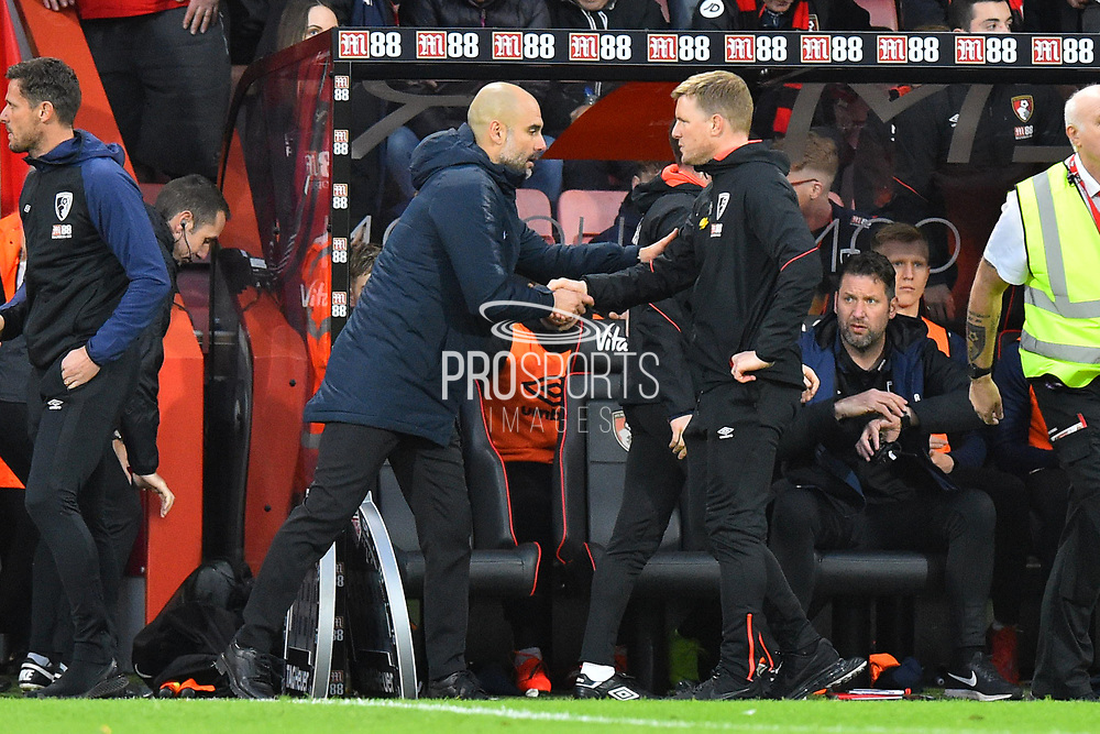Manchester City manager Pep Guardiola shakes hands with AFC Bournemouth manager Eddie Howe at full time after City beat Bournemouth 1-0 during the Premier League match between Bournemouth and Manchester City at the Vitality Stadium, Bournemouth, England on 2 March 2019.