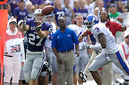 MANHATTAN, KS - OCTOBER 06:  Wide receiver Jordy Nelson #27 of the Kansas State Wildcats pulls in a pass for a 68-yard touchdown in front of defensive back Aqib Talib #3 of the Kansas Jayhawks in the first quarter, during a NCAA football game on October 6, 2007 at Bill Snyder Snyder Stadium in Manhattan, Kansas.  Kansas won 30-24.  (Photo by Peter Aiken/Getty Images)