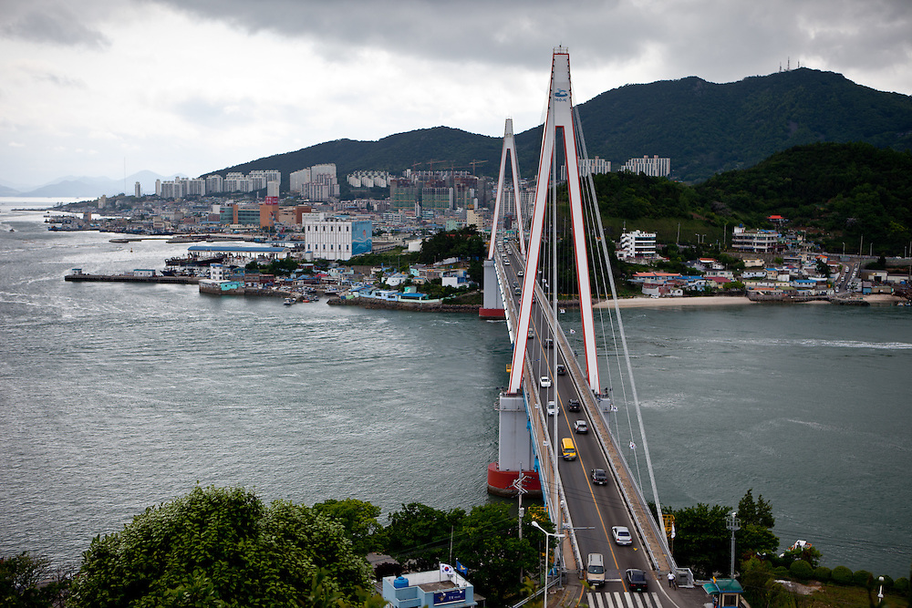 """Dolsan Bridge - a 450-meter cable stayed bridge - in the city of Yeosu. Yeosu will host the Expo 2012 exhibition  under the theme """"The Living Ocean and Coast"""". Yeosu (Yeosu-si) is a city in South Jeolla Province. Old Yeosu City, which was founded in 1949, Yeocheon City, founded in 1986, and Yeocheon County were merged into a new city in 1998."""