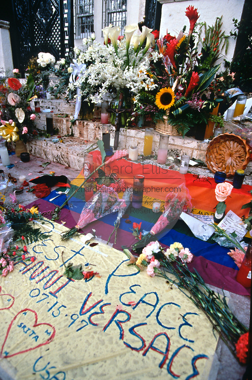 Well wishers leave flowers and letters at a makeshift memorial for murdered designer Gianni Versace in front of his Ocean Blvd home July 19, 1997 in Miami, FL.  Versace was murdered outside his Miami Beach home at the age of 50 by spree killer Andrew Cunanan.