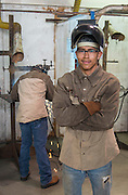 Northside High School student Emigdio Torrez poses for a photograph in a welding class at the Barbara Jordan High School for Careers, November 21, 2016.