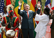 U.S. President George W. Bush dances with the Kankouran African Dance Company during a Malaria Awareness Day event in Rose Garden of the White House Washington, DC on 25 April 2007.