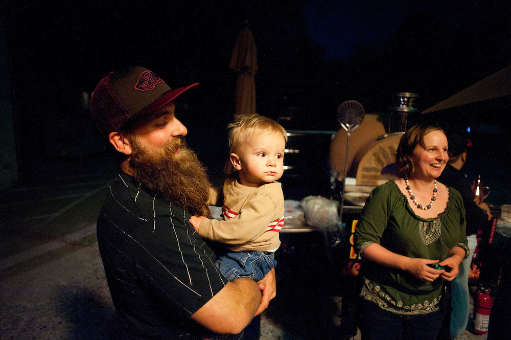 Andrew Shuler, left, holds his nephew Torr Shuler outside the Old Stone Church on Friday, June 4 during the 2010 Beard Team USA National Beard and Mustache Championships in Bend, Oregon.