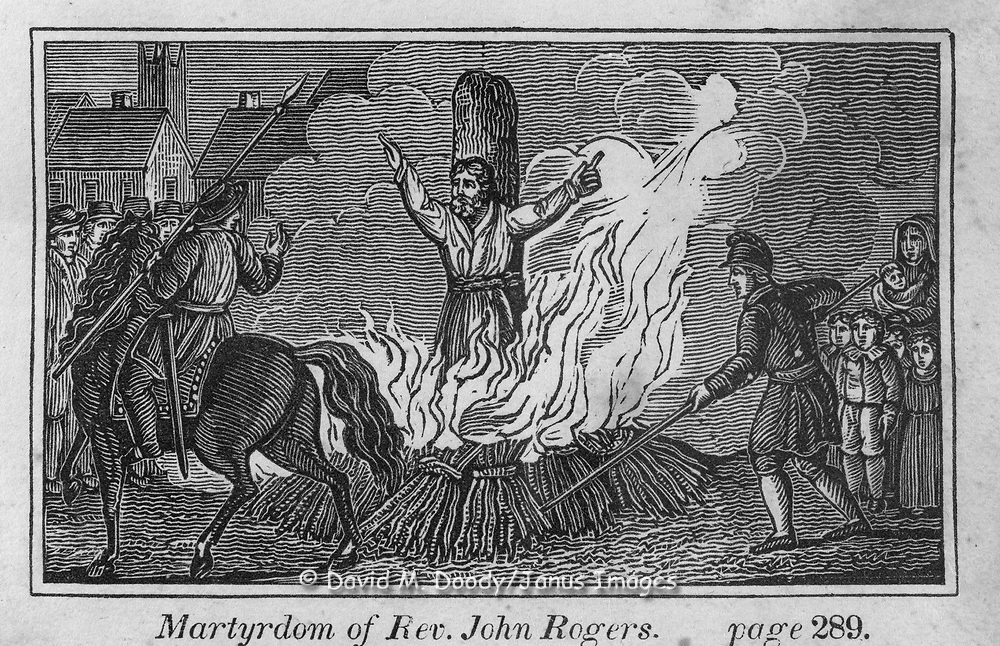 "Burning at the stake of Rev. John Rogers. Protestant vs Catholic violence. Vintage Woodcut Illustration from: ""Book of Martyrs"" Tortures carried out in the name of religion."