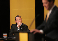 28 August 2007: Seven-time Tour de France winner Lance Armstrong (left) listen to Republican presidential hopeful and Senator Sam Brownback (R-KS) (right) delivers his opening statements at the LIVESTRONG Presidential Cancer Forum in Cedar Rapids, Iowa on August 28, 2007.