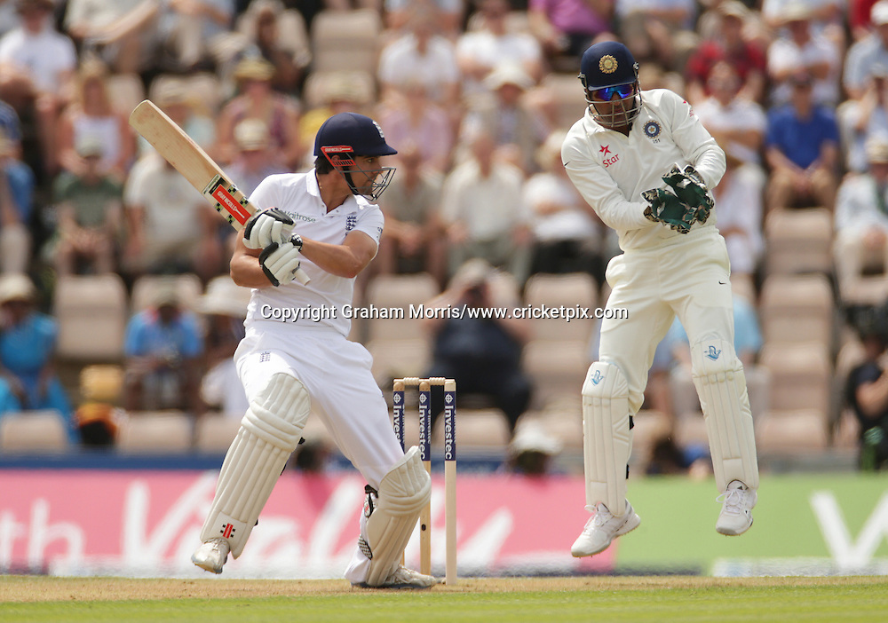 Alastair Cook cuts Ravindra Jadeja for four past wicket keeper Mahendra Singh Dhoni during the third Investec Test Match between England and India at the Ageas Bowl, Southampton. Photo: Graham Morris/www.cricketpix.com (Tel: +44 (0)20 8969 4192; Email: graham@cricketpix.com) 27/07/14