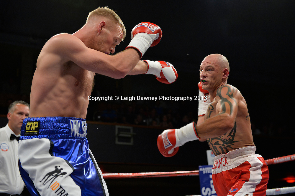 Craig Willshee (blue shorts) defeats Kieron Gray in a Super-Middleweight contest at Wolverhampton Civic Hall, Wolverhampton, 1st August 2014. Frank Warren in association with PJ Promotions.  © Credit: Leigh Dawney Photography.