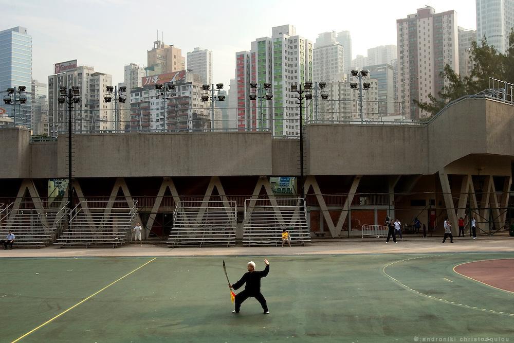Chinese man practicing his morning Tai Chi at Victoria park.