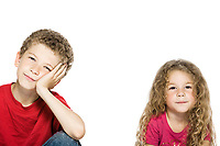 caucasian little boy bored and girl smiling portrait isolated studio on white background