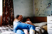Gavin and Rachel in bedroom at Hawthorne Road, High Wycombe. UK, 1980s.