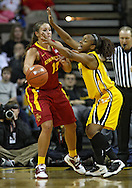 December 09 2010: Iowa St. guard Kelsey Bolte (11) tries to pass around Iowa guard Kachine Alexander (21) during the first half of their NCAA basketball game at Carver-Hawkeye Arena in Iowa City, Iowa on December 9, 2010. Iowa defeated Iowa State 62-40 in the Hy-Vee Cy-Hawk Series rivalry game.