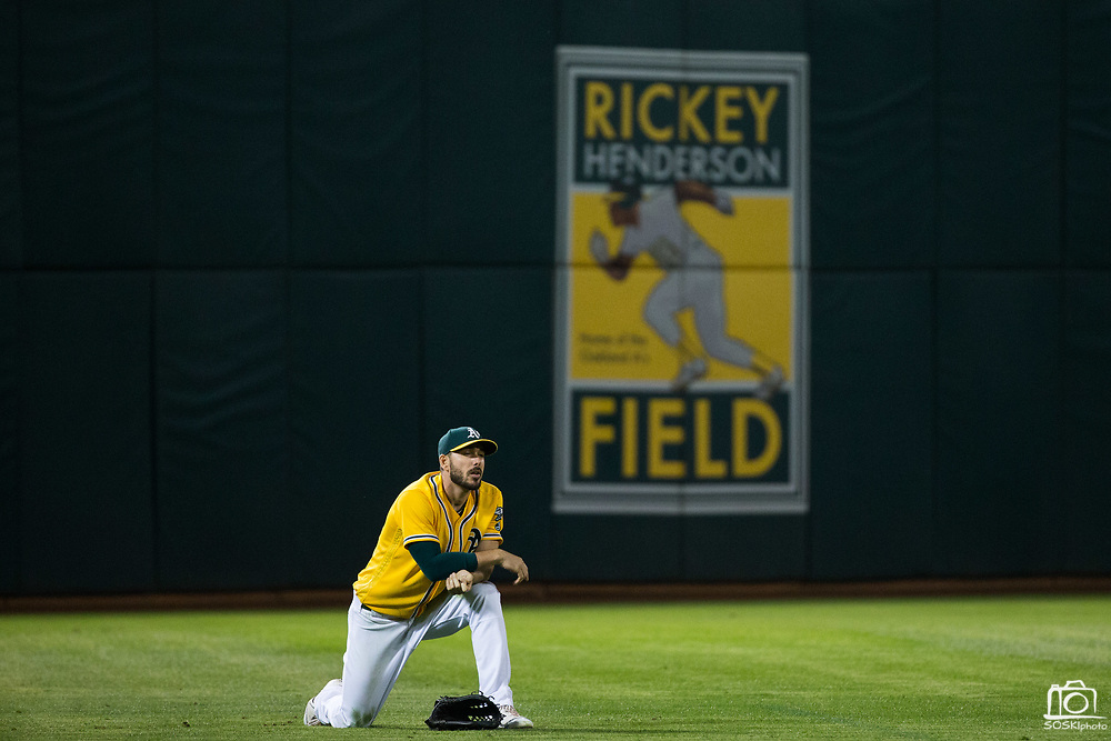 Oakland Athletics left fielder Matt Joyce (23) reacts to missing a diving catch for a Los Angeles Angels pop fly at Oakland Coliseum in Oakland, California, on September 5, 2017. (Stan Olszewski/Special to S.F. Examiner)